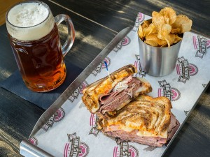 The Big Stick Das Melt Sandwich with Chips and Beer